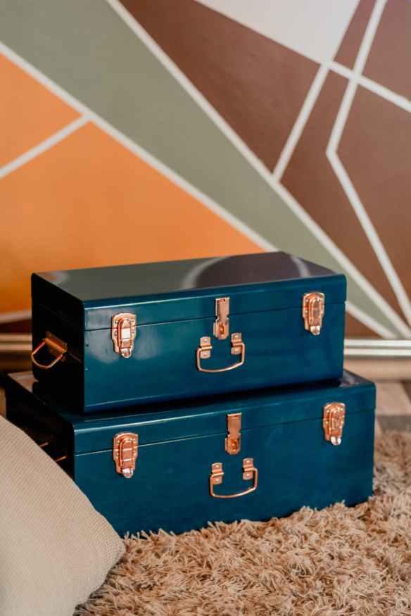two blue metal storage boxes